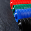 Set of four markers on black background — Stock Photo #64210445