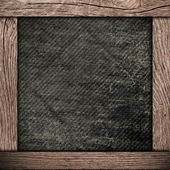 Wood frame with dark paper — Stock Photo