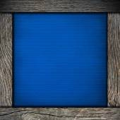 Wood frame with blue paper — Stock Photo