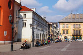KRAKOW, POLAND - March 07 2015: Unidentified tourists visiting small market square in Krakow, Poland on March 07 2015. Old town of Cracow listed as unesco heritage site — Stock Photo