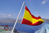Spanish flag on a mast, undulating in the wind  — Stock Photo