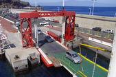 SAN SEBASTIAN DE LA GOMERA, AUGUST 8, 2014: People load cars on the ferry on August 12, La Gomera, Canary island, Spain — Stock Photo