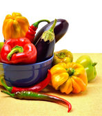Sweet pepper, aubergine, chilli pepper in the plate — Stock Photo