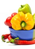 Sweet pepper, chili pepper in the plate  — Stock Photo