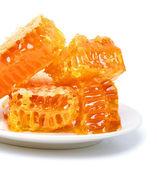 Blisko o strukturze plastra miodu na talerzu — Zdjęcie stockowe