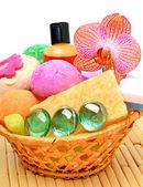 Soap, gel, bath bombs, sponges in the basket — Stockfoto