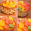 Bright sweets, lollipops, jellies in the basket on the wood — Stock Photo #55413499