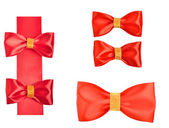 Shiny red satin bows — Stock Photo