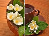 Thee beker met jasmijn bloemen op het hout — Stockfoto