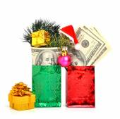 Handred dollars gift in pacage with christmas hat, bauble and pi — Stock Photo