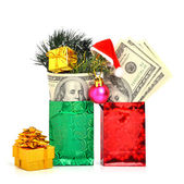 Hundred dollars gift in the package with christmas hat, bauble and pine twig isolate on white. Christmas — Stockfoto