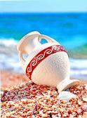 Beautiful vase on the seashore against blue sky — Stock Photo