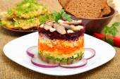 Russian traditional herring salad with beetroot, carrot, eggs on — Stock Photo