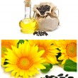 Carafe with vegetable oil and sunflowers — Stock Photo #61732509