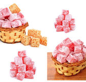 Turkish sweet delights in icing sugar in the basket isolated — Stock Photo