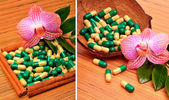 Coconut shell, capsules, tablets, an orchid flower — Stock Photo