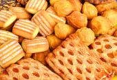 Shortbread, puffs and cookies covered with chocolate and grind n — Stock Photo