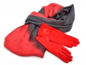 Stylish woman red gloves and a grey scarf isolated on white  — 图库照片