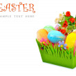 Easter colored cloth eggs, roses in the flowerbed. — Stock Photo #67763443