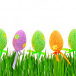 Fresh green grass and colored easter eggs — Stock Photo #68117407