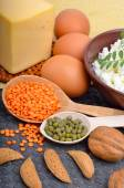 Protein food : eggs, almonds, lentils, cheese, walnut, and curd — Stock Photo