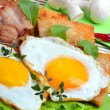 Bacon with sunny side up eggs served with toasts — Stock Photo #71898817
