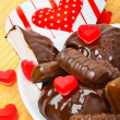 Cup of coffee with chocolate sweets a valentine heart on white p — Stock Photo #74094543
