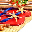 Red flip-flops, slippers with flowers on the wooden background — Stock Photo #74111601