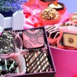 Assortment of chocolate sweets in gift boxes, lavender — Stock Photo #74112073