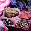 Chocolate sweets in gift boxes, lavender — Stock Photo #74112095