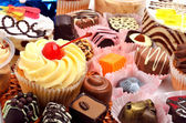 Chocolate sweets, muffins and cakes — Stock Photo