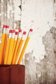 Group of yellow pencils in pencil holder — Stock Photo