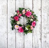 Flower wreath on vintage white background — Stock Photo
