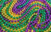 Mardi Gras beads background — Stock Photo