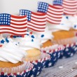 Row of patriotic cupcakes with American flags — Stock Photo #74819501