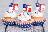 Patriotic 4th of July cupcakes with American flags — Stock Photo