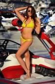 Woman in bikini on motor speed-boat — Stock Photo