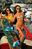 Bikini models posing on the sport speed- boat — Stock Photo
