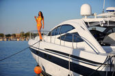 Woman on the deck of motorboat — Stock Photo