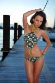 Brunette model on the pier during sunset time — Stock Photo