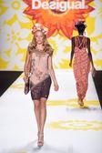 Model walks the runway at Desigual during Mercedes-Benz Fashion Week Spring 2015 — Stock Photo