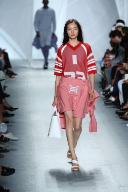 Model walks the runway at Lacoste during Mercedes-Benz Fashion Week