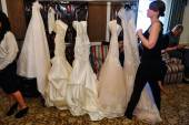 Bridal dresses backstage before the Jenny Lee Spring 2015 Bridal collection show — Stock Photo