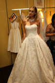 Model getting ready backstage wearing Oleg Cassini Fall 2015 Bridal collection — Stock Photo