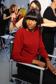 Models getting ready backstage with makeup and hair during Made in the USA Spring 2015 lingerie showcase preparations — Stock Photo