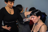 Models getting ready backstage with makeup and hair during Made in the USA Spring 2015 lingerie showcase preparations — Photo