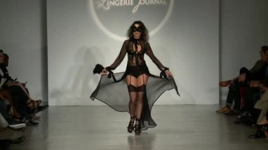 NEW YORK, NY - OCTOBER 25: A model walks runway at Finale Runway Show during Lingerie Fashion week closing benefit Spring 2015 collections at the Center 548 on October 25, 2014 in New York City. — Stockvideo