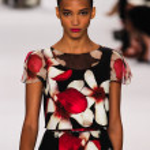 Model Cora Emmanuel walk the runway at the Carolina Herrera fashion show — Stock Photo #57699589