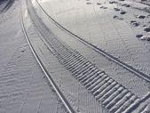 Fresh snow groomer tracks — Stock Photo
