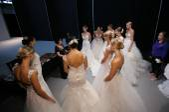 Designer Eve Muscio instruct models — Stock Photo